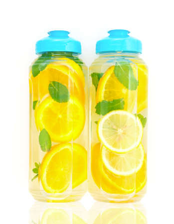 Homemade detox water made from orange, lime and pepermint. Refreshment drink for good health photo