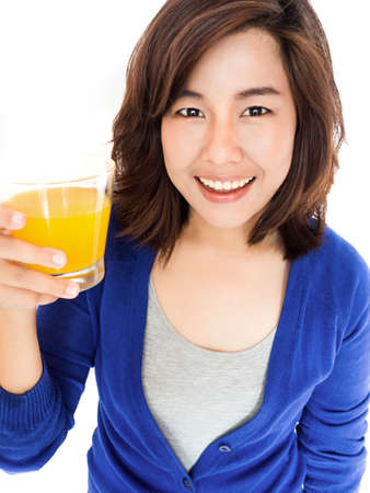 Isolated portrait of young happy woman drinking orange juice smiling on white background. Pretty female model happy smiling. photo