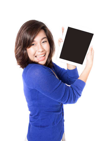 Isolated portrait of beautiful young woman with digital tablet on white background. Pretty female model smiling and feeling great. photo