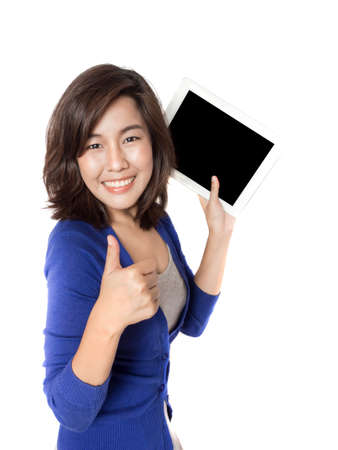 Isolated portrait of beautiful young woman thumb up with digital tablet on white background. Pretty female model smiling and feeling great. photo
