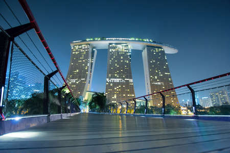 marina bay sand: SINGAPORE - MARCH10, 2014: Marina Bay Sands. The iconic design has transformed Singapores skyline and tourism landscape since it opened on 27 April 2010. Designed by architect Moshe Safdie. Editorial