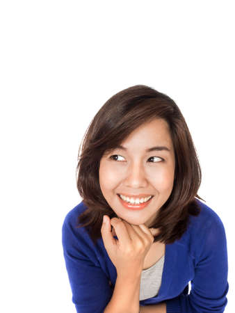 hesitations: Asian woman thinking in looking pensive and happy in casual clothes isolated on white background.