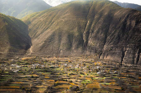 Landscape of small village and big mountain nearby Mingyong Glacier ,Yunnan Province,China  photo