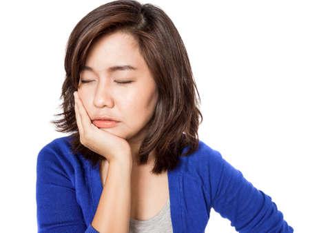 Vrouw met kiespijn met haar hand op haar wang Stockfoto
