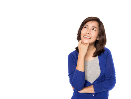hesitations: Asian woman thinking and happy in casual clothes isolated on white background.