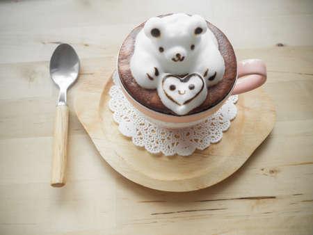adore: Bear hugging heart in coffee cup. Adorable latte art 3d design.