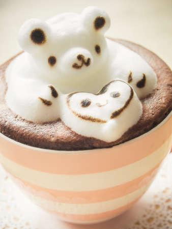 Bear hugging heart in coffee cup. Adorable latte art 3d design. photo