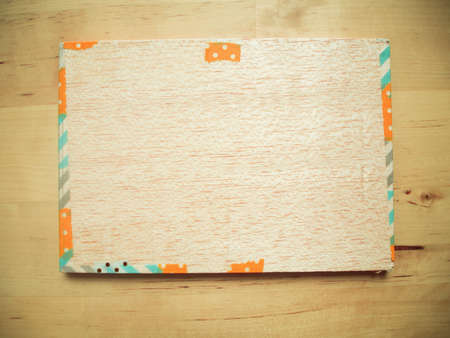 decore: Wood board with fancy decore border on wooden background
