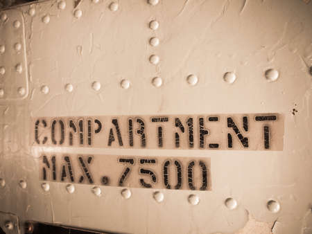 compartments: Grunge max compartment warning sign.