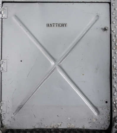 compartment: Old metal batterry compartment on military aircraft.