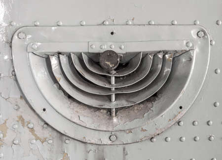 grille: Old ventilation grille on military aircraft.