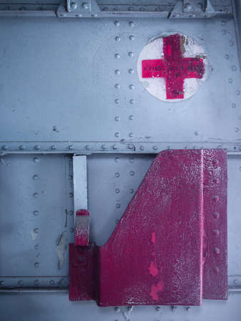 humanitarian aid: BANGKOK THAILAND - 8 NOVEMBER, 2014:Red cross sign on military aircraft. The American Red Cross is part of the world's largest humanitarian network with 13 million volunteers in 187 countries.