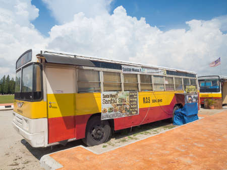 old bus: MALACCA, MALAYSIA - NOVEMBER 15,2014: Adaptive restaurant from old bus at beach side in Malacca, Malaysia.