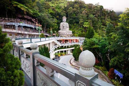 malaysia culture: Genting Highlands, Malaysia - NOVEMBER 15, 2014: Large stone Buddha statue at Chin Swee Caves Temple in Genting Highlands, Pahang, Malaysia
