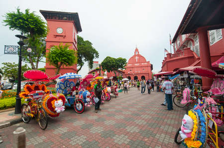 trishaw: MALACCA, MALAYSIA - NOVEMBER 15,2014: Decorative trishaw at Malacca city Malaysia. A popular historic tourist attraction in Melaka Malaysia with flower decorated tricycles for hire.