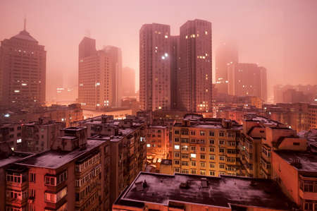 Scene of cites covered by fog after snow storm at Downtown of the Dalian, China.