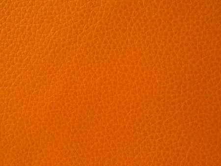pu: Orange leather texture closeup background. Stock Photo