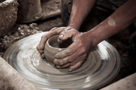 pottery: Artisan hands making clay pot