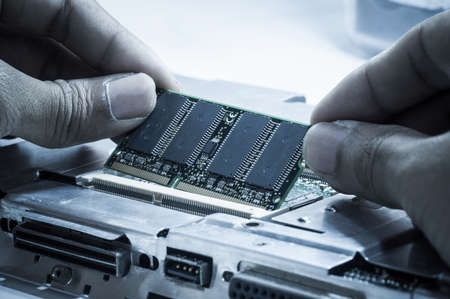 Upgrading RAM memory card on laptop computer motherboard