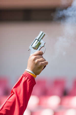 Image of fried pistol gun in red shirt man hand photo