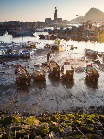 tou: Dalian, China - January 22, 2014 : Evening scene at Fisherman Wharf (Yu Ren Ma Tou). Dalian, China.
