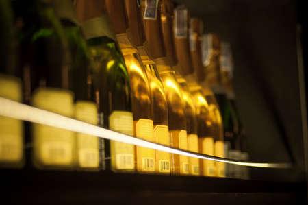 Stock of wine bottles in cellar photo