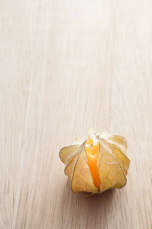 alkekengi: Macro detail image of Cape gooseberry on wooden background Stock Photo