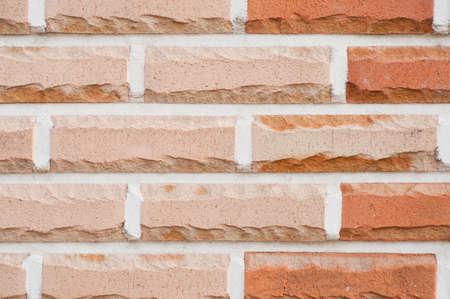 Red pastel brick wall texture grunge background photo