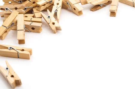 clothespins: Laundry day background, clothespins on white space Stock Photo