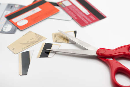 wealth concept: Cuting credit cards with scissors.
