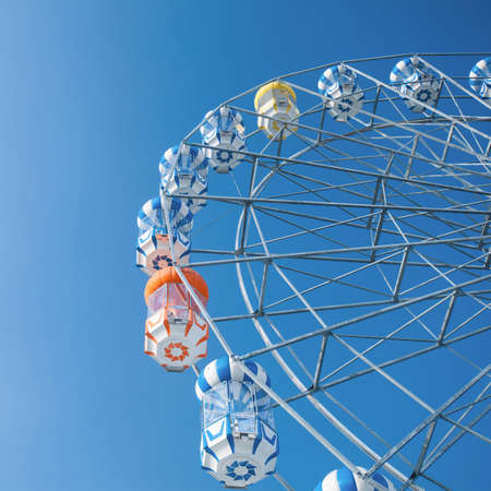 Ferris Wheel Over Blue Sky photo