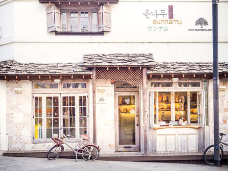 "shopfront: SEOUL ,SOUTH KOREA - FEBRUARY 25, 2015: A street cafe and restuarant around city of Seoul, Korea. The wildly popular TV drama, ""Coffee Prince"" make Korea's love of coffee. Editorial"