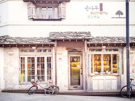 "korean culture: SEOUL ,SOUTH KOREA - FEBRUARY 25, 2015: A street cafe and restuarant around city of Seoul, Korea. The wildly popular TV drama, ""Coffee Prince"" make Korea's love of coffee. Editorial"