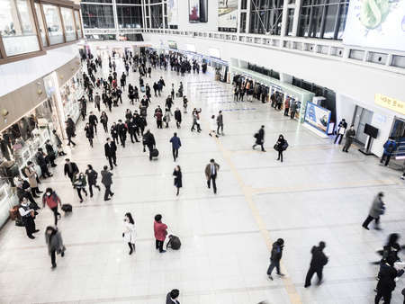 terminus: SEOUL, SOUTH KOREA - FEBRUARY 25, 2015 : Passengers inside of Seoul Station. The station is the terminus for the countrys high-speed train KTX.