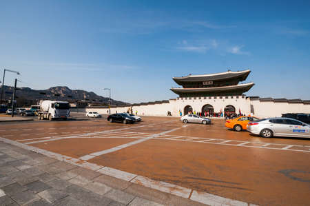 main gate: Seoul, South Korea - FEBRUARY 27, 2015: The photo of traffic at the Gwanghwamun Gate, the main gate of Gyeongbokgung palace.