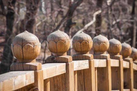 banister: Old carving lotus handrail on wood bridge