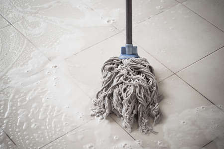 shiny floor: Floor cleaning with mob and cleanser foam.