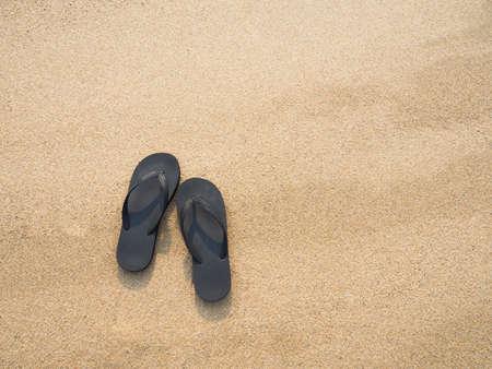 flip flops: Flip flops on a sandy beach