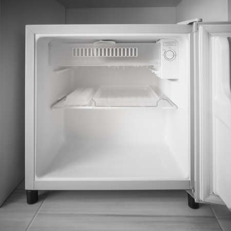 Empty mini fridge. Stock Photo