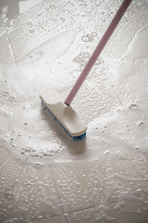 mob: Floor cleaning with mob and cleanser foam.