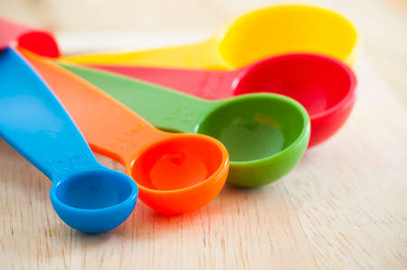 at close quarters: Measuring Spoons set on wood background Stock Photo