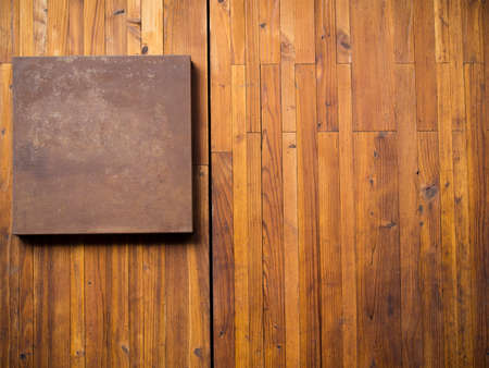 nameboard: Metal plate on wood plank background Stock Photo