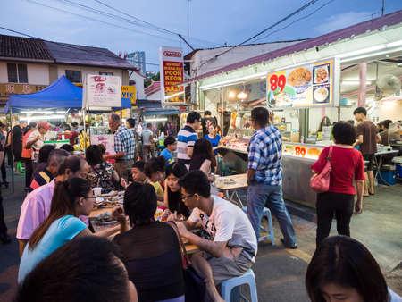 Malacca Malaysia  November 15 2014: People enjoy dining street foods at Jonker street in Malacca.