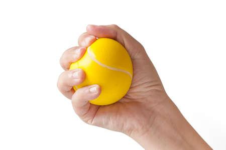 puÑos: Mano de la mujer apretando una pelota anti-estrés