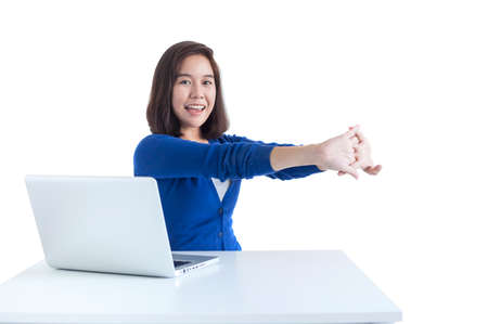tired: Business woman do stretch with laptop in front isolated over white background. Stock Photo