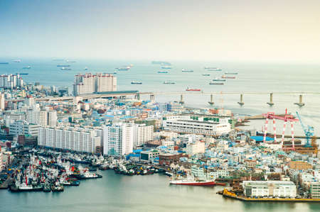 Busan, South Korea - February 26, 2015 : View of Busan port. Busan has one of the worlds largest ports can handle more than 13.2 million shipping containers per year. Stock Photo