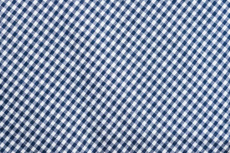 checked: Blue checked clothes fabric texture background.