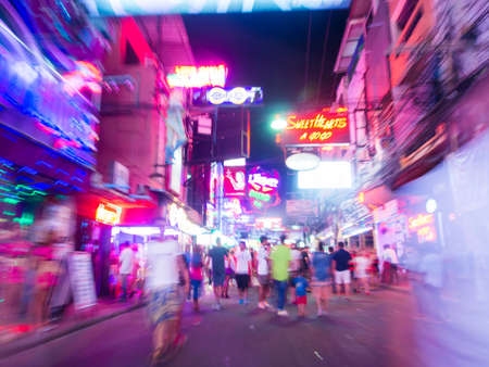 night life: Pattaya, Thailand - July 23, 2015: Motion blur image of people on a Walking Street Pattaya. Walking Street is a popular tourist attraction.