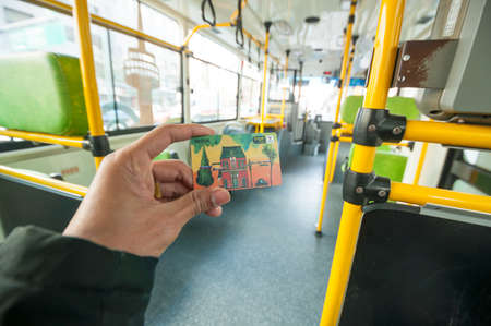 tourists stop: Seoul, South Korea - March 04, 2015 : Passenger showing T Money Card on Seoul public bus. The card can be use many public transport in South Korea.