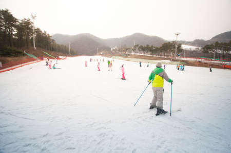 beginner: People at beginner slope of ski resort.
